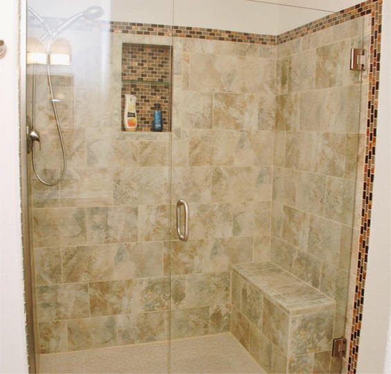custom tile shower remodeling project with build in for shampoo bottles and bench